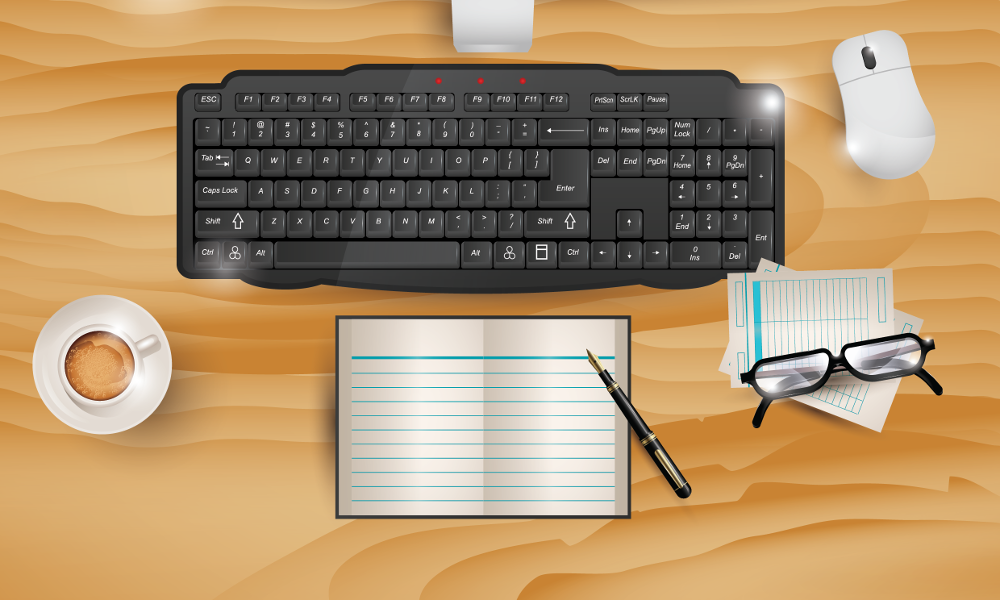 Computer keyboard, mouse, papers and coffee